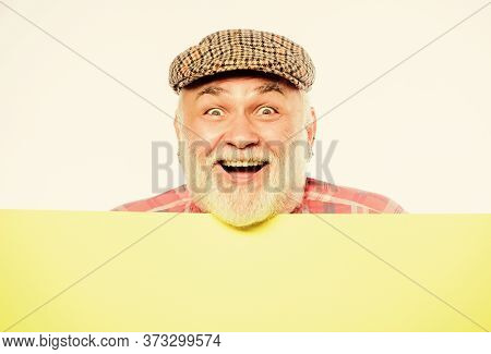 Elderly Person. Announcement Concept. Senior Bearded Emotional Man Peek Out Of Banner Place Announce