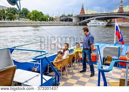 Moscow, Russia. June 30, 2015: Dad And Three Children Sitting On A Pleasure Boat On The Moscow River
