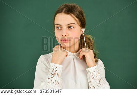 Homeschooling Online Education. Audio Translation. Audio Learning Concept. Girl In Earphones Listeni