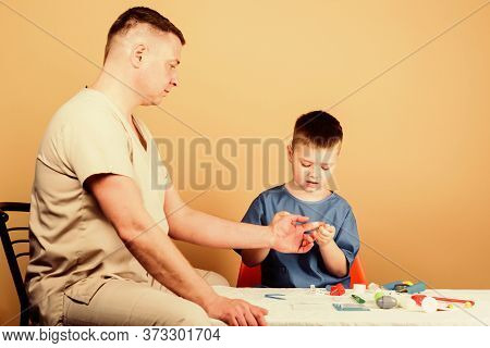 Medical Examination. Boy Cute Child And His Father Doctor. Hospital Worker. Medical Service. Analysi