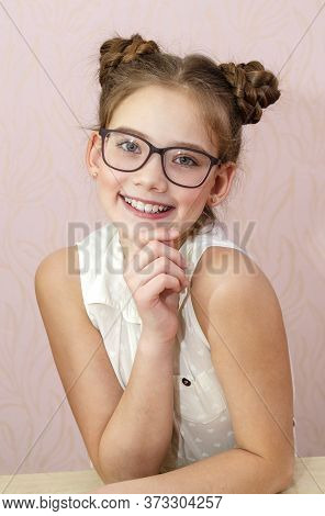 Cute Little Girl Child Preteen In Eyeglasses Education, School And Vision Concept Isolated On A Pink