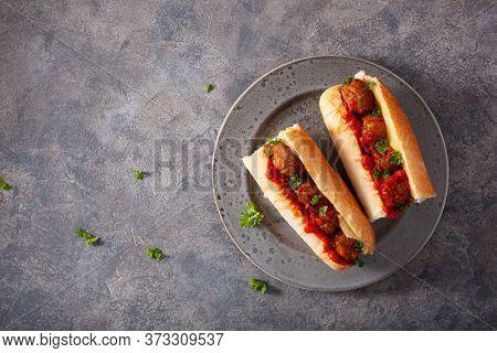 meatball sub sandwich with cheese and marinara tomato sauce. american italian fast food