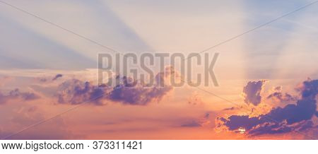 Beautiful Sky With Sun Rays. Majestic Colorful Clouds In Pastel Tones.