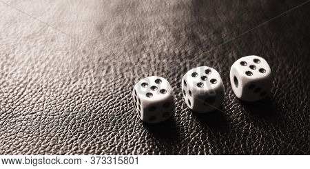 Three Dices On The Black Table. Bw Photo