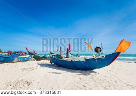 Vietnam Coastal Motorbike Trip From Ba Ria To La Gi. Landscape With Local Sailboats, Blue Sky During