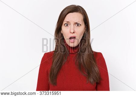 Perplexed Shocked Young Brunette Woman Girl In Casual Red Clothes Posing Isolated On White Backgroun