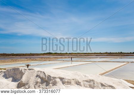 Natural Salt Factory With Blue Sky During Sunny Day On The South Of Mui Ne. Vietnam Coastal Motorbik