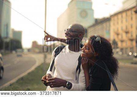 portrait of young smiling couple in the street