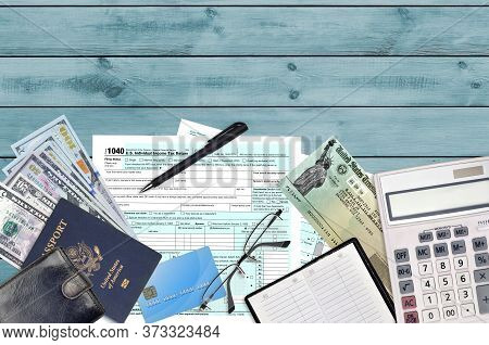 Irs Form 1040 U.s. Individual Income Tax Return With Refund Check Lies On Flat Lay Office Table And