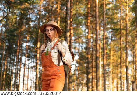 Portrait Of Woman Botanist With Backpack On Ecological Hiking Trail In Summer. Naturalist Exploring