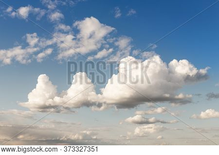 Weird Unusual Animal Silhouette Fantasy Dream Cloudscape On Beautiful Evening Blue Sky Background. F