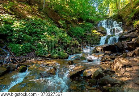 Carpathian Waterfall Shypot In The Morning. Beautiful Nature Scenery. Popular Tourist Attraction