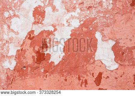 Pink Texture Of An Old Wall. Vintage Background Of Dirty Rough Plaster