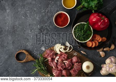 Ingredients For Cooking Meat With Vegetables On Dark Background Top View. Preparation Beef Meat