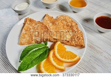 Crepes With Sour Cream On White Plate , Copy Space. Delicious Homemade Crepes For Breakfast.thin Thr