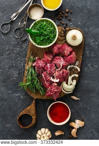 Raw Meat And Vegetables On Dark Background Top View. Cooking Beef Meat