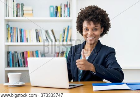 Happy African American Business Trainee Working At Computer Indoors At Home Or At Office