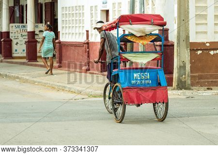 Toliara, Madagascar - January 10th, 2019: A Man Riding A Cycle Pousse Pousse With The Name Of Messi