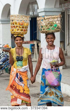 Toliara, Madagascar - January 10th, 2019: Two Local Malagasy Woman With Baskets On Their Head Sellin