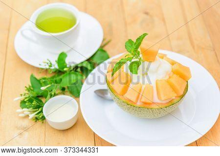 Melon Bingsu With Sweetened Condensed Milk On Wood Table