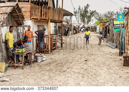 Andavadoaka, Madagascar - January 13th, 2019: Sandy Street With Store Stall And People Trading Food