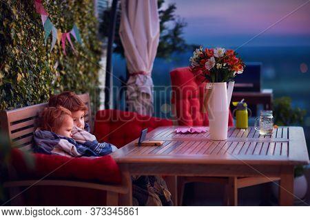 Cute Siblings Having Fun, Watching Cartoons On The Phone, Spending Time On Cozy Rooftop Patio On Sum