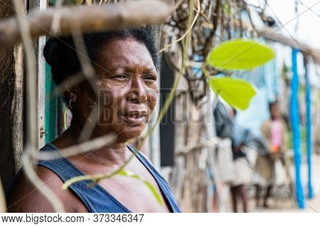 Andavadoaka, Madagascar - January 13th, 2019: Portrait Of A Local Mature Malagasy Woman Looking Away