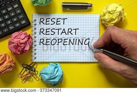 Mail Hand Writing 'reset Restart Reopening' On White Note, Beautiful Yellow Background, Colored Pape
