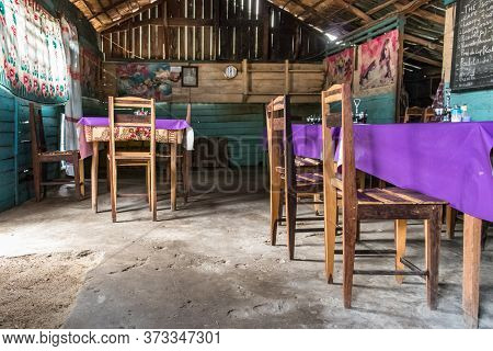 Andavadoaka, Madagascar - January 13th, 2019: Wooden Chairs And Tables In A Rustic Restaurant In Cen