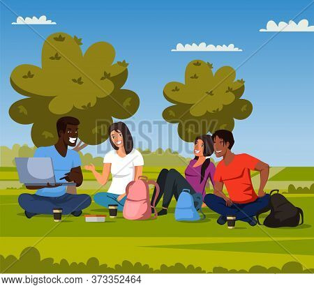 Male And Female Students Rest, Study In Campus Park. Multiracial Teenagers In Casual Clothes Watchin