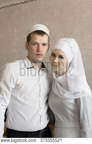 Couple Young Muslim Man And Women Using Smart Phone Contact With Partner Together In Outdoor Buildin
