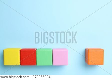Flat Lay Composition With Colorful Cubes On Light Blue Background, Space For Text. Pareto Principle