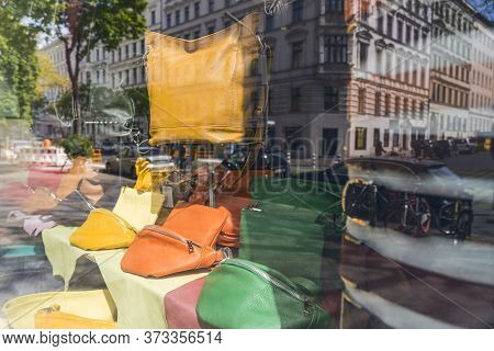 Reflection Of Street Life In A Shop Window With Leather Bags