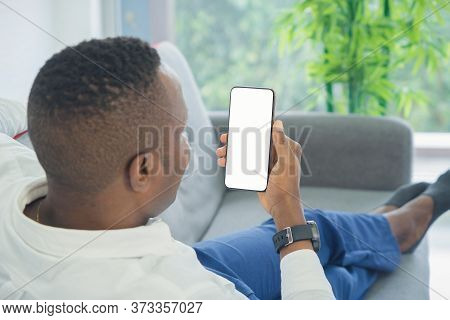 Business Black American Man, African Person Using A Smartphone Or Mobile Phone With Blank Screen Spa