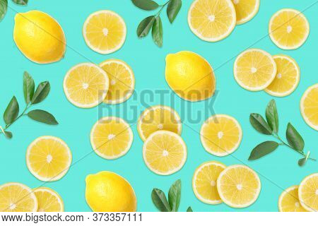 Flat Lay Composition With Lemons And Leaves On Aquamarine Blue Background