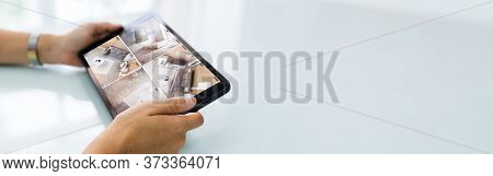 Surveillance Security Camera Cctv Video Footage On Tablet