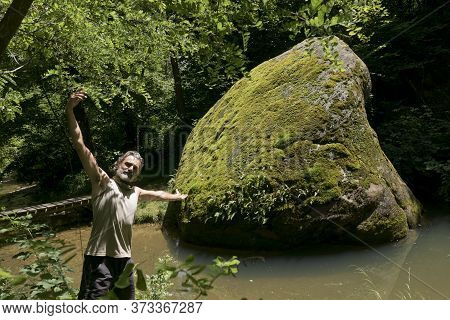 Man Visiting An Ancient Sacred Place With Glacial Hera Giant Erratic Stones Connected To Ancestral M