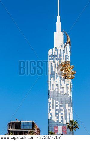 Batumi, Adjara, Georgia - May 3, 2018: Technological University Skyscraper Tower With Golden Ferris