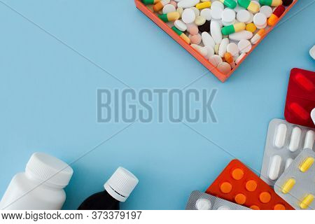 Colorful Tablets And Capsules In An Orange Box, Antiseptic Bottle, Container, Tablets In A Package,