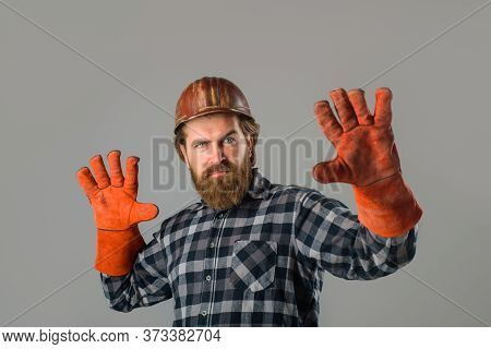 Repairment Concept. Workman In Hardhat. Builder In Work Gloves. Builder Work. Building, Industry, Te