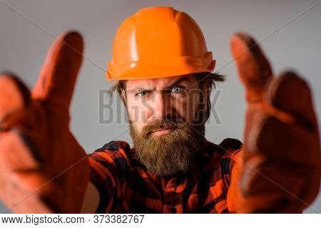 Workman In Hardhat And Work Gloves. Builder Work. Building, Industry, Technology. Builder In Hard Ha