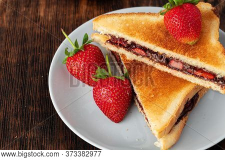 Sandwich Toast With Chocolate Paste And Cut Strawberry