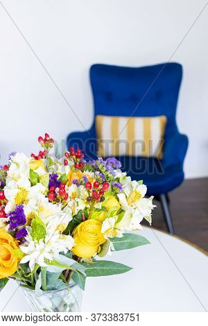 Flower Arrangement With Yellow Roses And Astromelias Decorating The Home Room