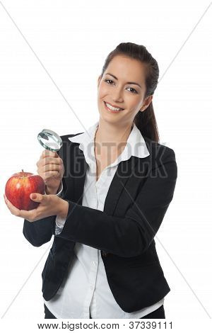 Businesswoman With Apple And Magnifer