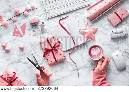 Christmas Flat Lay On Marble Background. Hands With Scissors And Cup Of Coffee With Latte Art In Sha