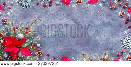Red And Green Xmas Decorations On Dark Textured Background. Panoramic Christmas Background, Flat Lay