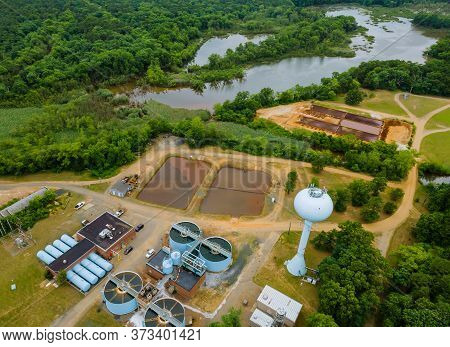 Top Aerial View Of Purification Water Tanks Of Modern Wastewater Treatment Processing Plant
