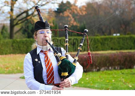 Minsk/ Belarus - October 31 2018: Piper Girl Plays The Bagpipes In The Park