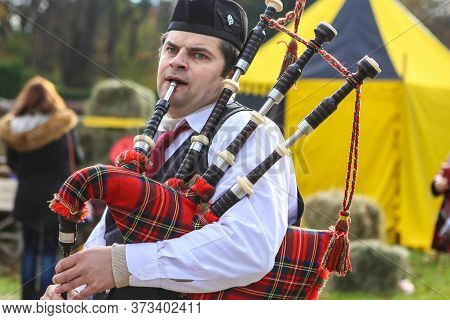 Minsk/ Belarus - October 31 2018: Piper Plays The Bagpipes In The Park