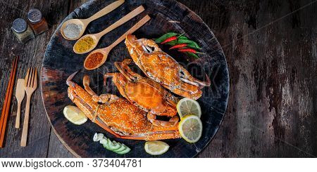 Jumbo Crab And Spices Herb On Dark Background And Space With Text